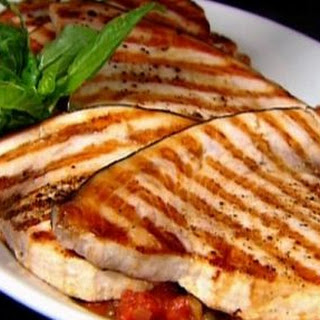 Swordfish With Tomatoes And Capers.