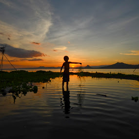 Earth Day by Jeremy Mendoza - Landscapes Sunsets & Sunrises ( taallake, sunset, silhouette, philippines, earthday, , Hope, relax, tranquil, relaxing, tranquility, #GARYFONGDRAMATICLIGHT, #WTFBOBDAVIS )