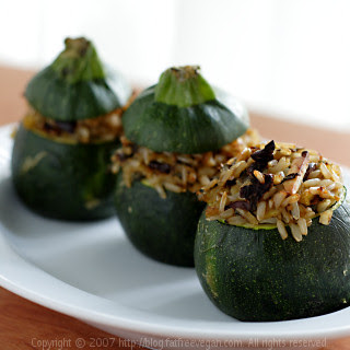 Eight-Ball Zucchini Stuffed with Rice, Basil, and Sun-dried Tomatoes.