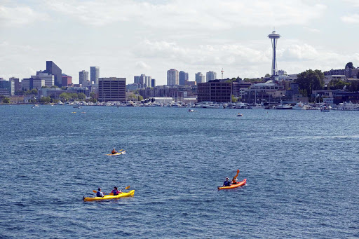 Kayakers enjoy a sunny day on the waters of Lake Union.
