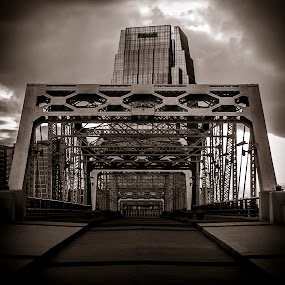 The walking bridge by Luke Popwell - Buildings & Architecture Bridges & Suspended Structures ( clouds, water, nashvegas, city by the river, art, tennessee, walking bridge, scenic, landscape, artwork, city scape, sky, sunset, nashville, outdoors, scenery, down town, river, waterway )