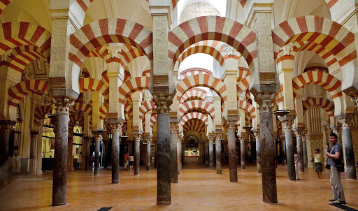 In Córdoba, Spain, home to a culturaly rich heritage, you can visit La Mezquita mosque and its famed red striped arches.