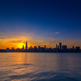 Chicago IL Skyline by MIGUEL CORREA - City,  Street & Park  Skylines ( water, michigan, skyline, building, lake michigan, sunset, buildings, lake, il, chicago, sun )