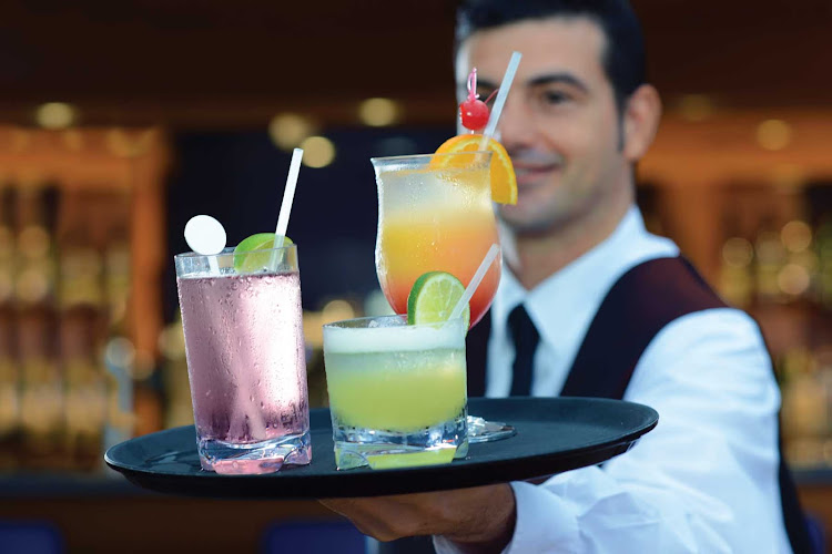 Get your evening started with a colorful tropical drink in Oceania Riviera's Waves bar.