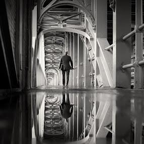 Mirror Man by Steve Jackson - Buildings & Architecture Bridges & Suspended Structures ( bridge pedestrian suit reflection puddle )