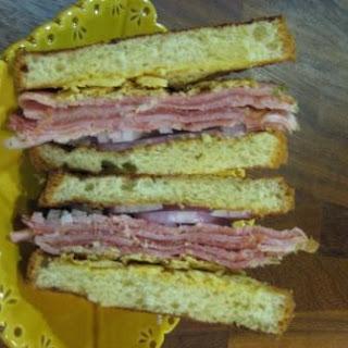 Sandwich w/ Ham, Proscuitto, Crispy Gruyere & Lemon Aioli.