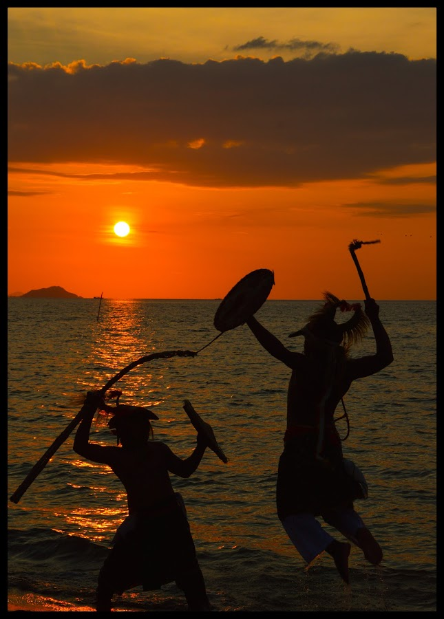 caci dance in the beach by Rinal Dino - Landscapes Sunsets & Sunrises ( sunset, landscape, people, culture )