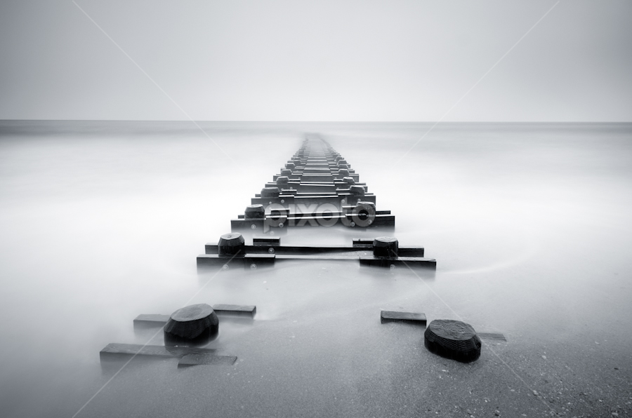 by Junel Corales - Landscapes Waterscapes ( b&w, black and white, minimalism, long branch, sea, seascape, jetty, beach, big stopper, new jersey, lee filters, simplicity, long branch beach, long exposure, nj, drain pipe )