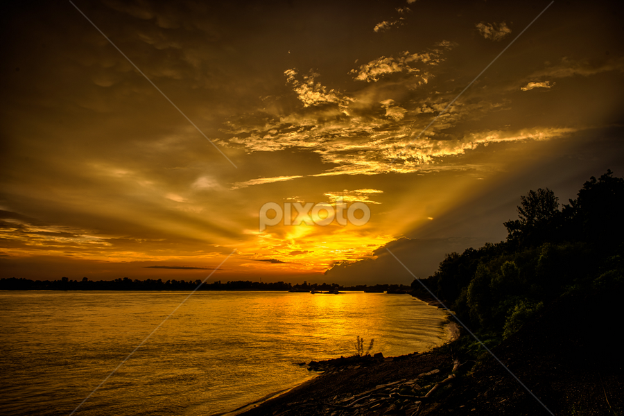 Sunset on the MS River by Sheldon Anderson - Landscapes Sunsets & Sunrises ( water, clouds, reflection, barge, sunset, sun-rays, storm clouds, ms river, boat, river,  )