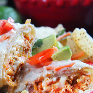 Smothered Buffalo Chicken Baked Burritos with Creamy Lime Ranch Sauce.