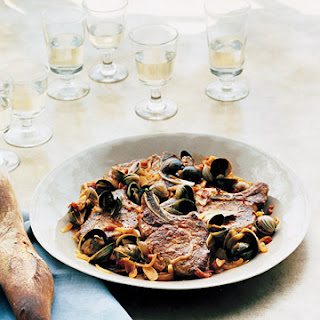 Pork Chops and Clams in Garlic Broth