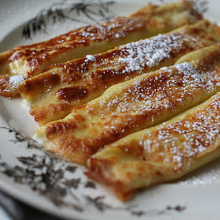 Caramelized Crepes Filled with Fresh Cheese.