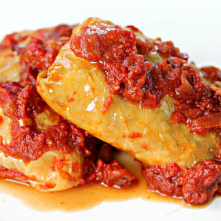 Bratwurst-Stuffed Cabbage Rolls With Smoky Bacon-Tomato Sauce.