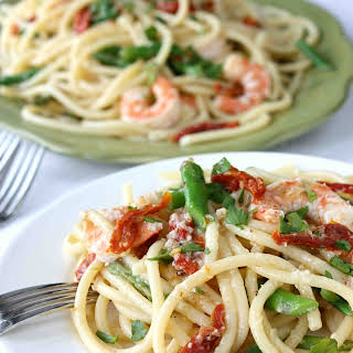 Shrimp, Sun-Dried Tomato & Asparagus Bucatini Pasta with White Wine & Garlic Sauce.