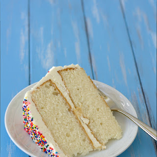 Fluffy Vanilla Cake with Whipped Vanilla Bean Frosting {William's 1st Birthday!}.