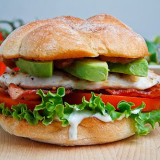 Grilled Chicken Club Sandwich with Avocado and Chipotle Caramelized Onions.
