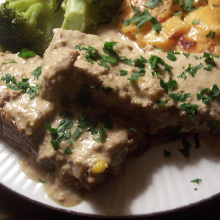 South West Meatloaf with Green Chile Herb Pepita Cream Sauce.