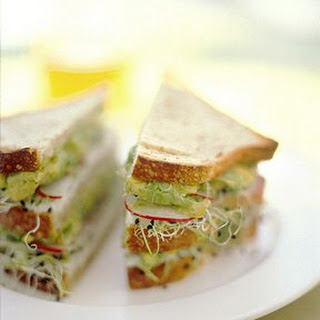 Avocado and Sprout Club Sandwich.