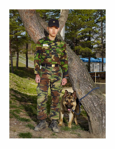 "An army dog, ""Adol,"" and a private, April 2010"