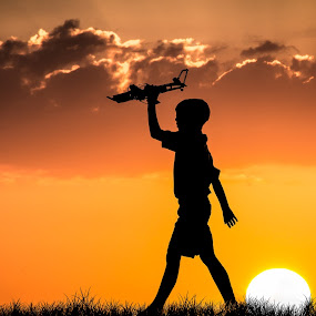 FootSteps by Chris Thomas - Babies & Children Children Candids ( contrast, child, silhouette, sunset, shadow, play,  )