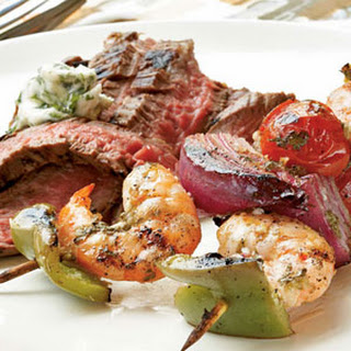 Ginger-Lime Marinated Shrimp Kebabs with Grilled Flank Steak and Cilantro Butter.