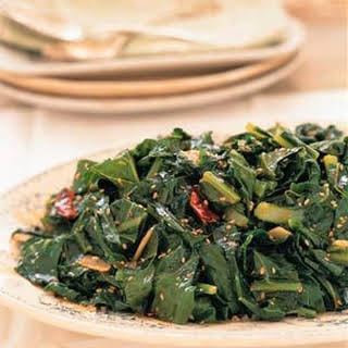 Collard Greens with Benne Seeds and Chili Oil.