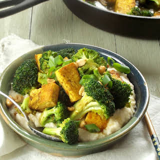 Malaysian Tofu Broccoli Stir Fry Over Creamy Coconut Grits.