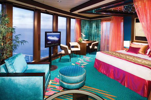 Norwegian-Gem-stateroom-Deluxe-Owners-Suite - Floor-to-ceiling windows in the Deluxe Owner's Suite on Norwegian Gem give you perfect views of the ocean and sky.