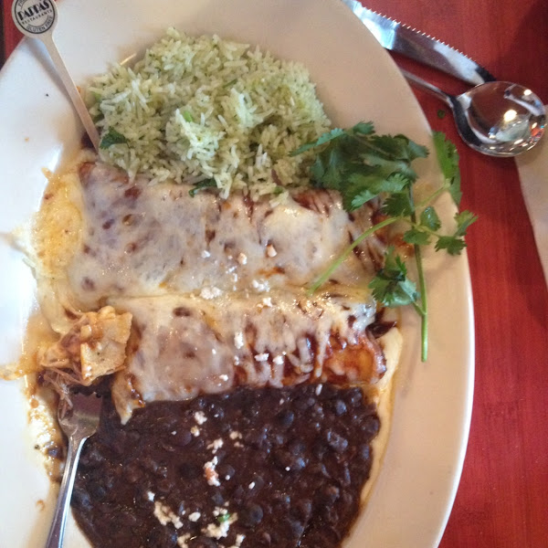 Beef brisket enchiladas with refried black beans and cilantro lime rice