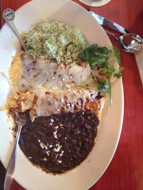 Beef brisket enchiladas with refried black beans and ...