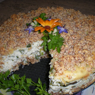 Savory Asparagus Ricotta Cheesecake with Almond Swiss Cheese Crust and Topping..
