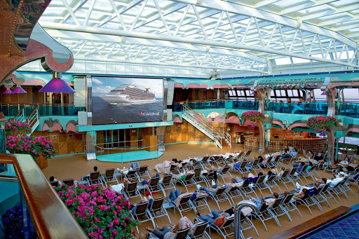 Carnival-Splendor-Seaside-Theatre - Catch Hollywood movies and special showings on the big digital screen in the poolside Seaside Theatre aboard Carnival Splendor.