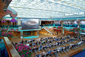 Catch Hollywood movies and special showings on the big digital screen in the poolside Seaside Theatre aboard Carnival Splendor.