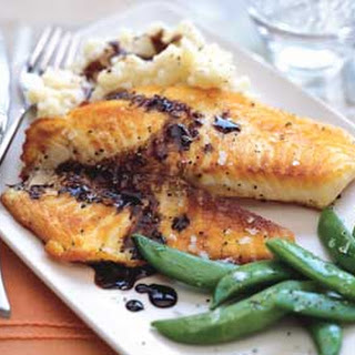 Tilapia with Balsamic Butter Sauce, Thyme Mashed Potatoes, and Sugar Snap Peas.