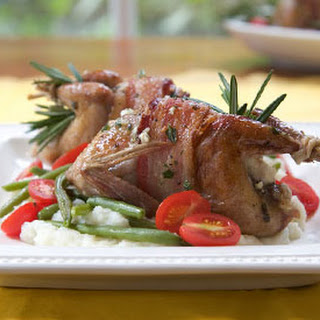 Bacon-Wrapped Quail Stuffed with Goat Cheese.