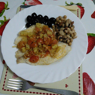 Tilapia Fish with chilli oil, cherry tomatoes and potatoes.