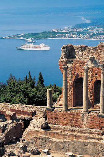 Travel on Regent Seven Seas and explore ancient Greek ruins perched on a hillside during a shore excursion to Taormina, Silicy.