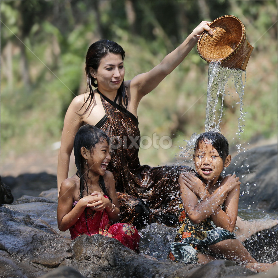 by DODY KUSUMA  - People Family ( mom with kids )