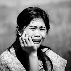 women crying by Yogi Duha - Black & White Portraits & People