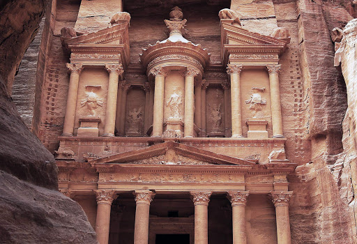Treasury_at_Petra_Jordan - Feel like Indiana Jones when Seabourn ship docks at Petra, Jordan, and you come face to face with The Treasury, an iconic structure with intricate carvings and columns. Petra has been a UNESCO World Heritage Site since 1985.
