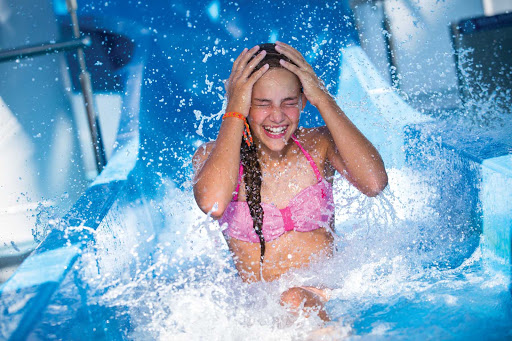 Norwegian-Aqua-Park-slide-girl - Get a thrill by zipping down the Aqua Park water slide during your Norwegian Cruise Line vacation.