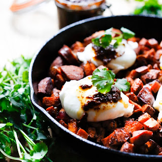 Harissa Sweet Potato Hash with Poached Eggs and Merguez Sausage