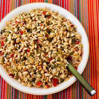 Red and Green Christmas Rice with Bell Peppers, Parmesan, and Pine Nuts.