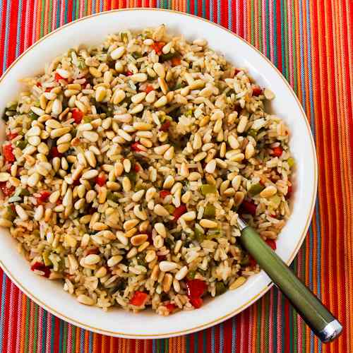 Red and Green Christmas Rice with Bell Peppers, Parmesan, and Pine Nuts Recipe