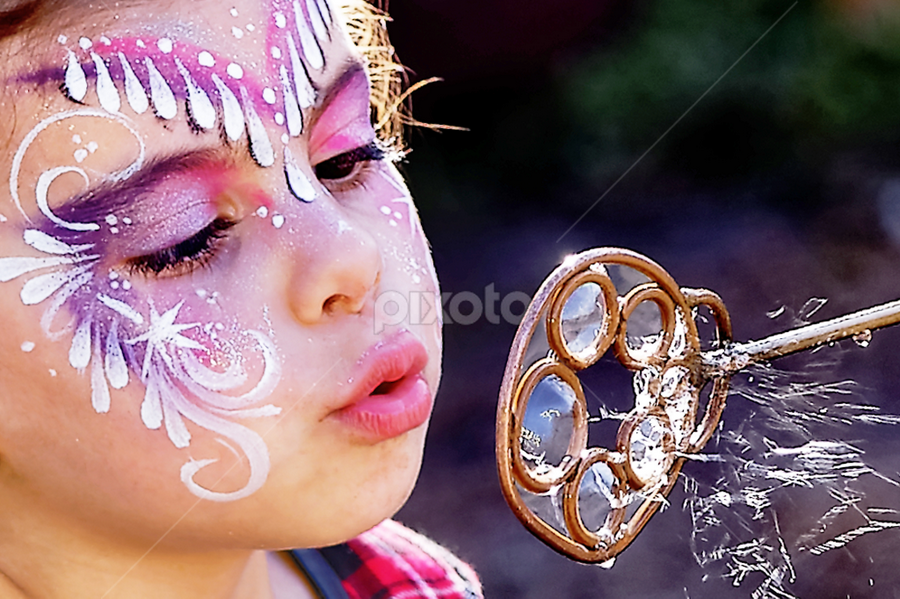 Little Girl with Painted Face Blowing Bubbles by Patrick Sherlock - Babies & Children Children Candids