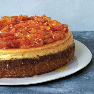 Orange Cheesecake with Candied Kumquats.