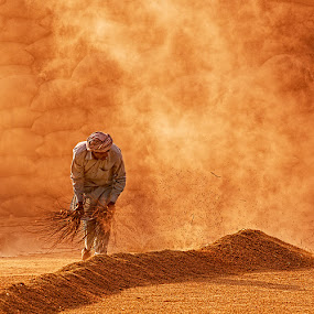 Rice Brooming by Nayyer Reza - People Professional People ( pakistan, lahore, rice, rice processing, village, color, sheller, worker, nayyer, skilled worker, reza, colors, landscape, portrait, object, filter forge )