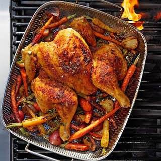 Grilled Spatchcock Chicken with Carrots and Potatoes.