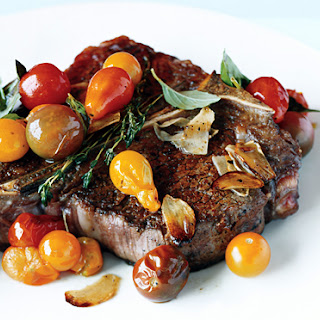 Porterhouse Steak with Pan Seared Cherry Tomatoes.