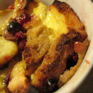 Individual Cranberry-Ginger Bread Puddings.